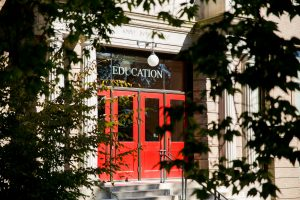 red doors of the education building which houses the master's in special education program
