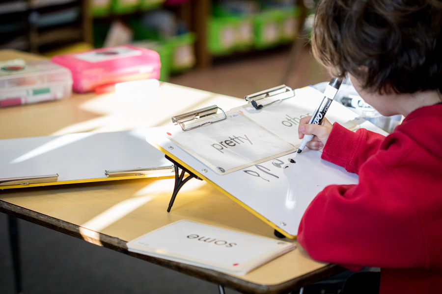A child writing at a desk.