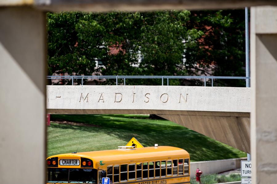 Bridge over road with a school bus below.